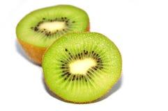 Kiwi Fruit cut into half. Isolated Kiwi Fruit cut into half with white background Stock Photo