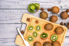 Kiwi fruit cut in slices on wooden cutting board. Upper view Stock Photography
