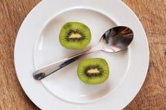 Kiwi fruit cut. Stock Photos