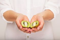 Kiwi Fruit Cut in Two Segments Royalty Free Stock Photography
