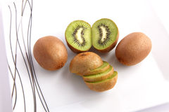 Kiwi Fruit face on white Dish Stock Photography
