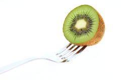 Kiwi fruit and fork Royalty Free Stock Photography