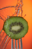 Kiwi fruit fork water concept closeup poster Royalty Free Stock Images