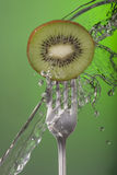 Kiwi fruit fork water concept green health poster Royalty Free Stock Images