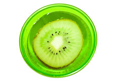 Kiwi fruit in a glass with water Royalty Free Stock Photo