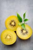 Kiwi fruit on a gray metal background. Royalty Free Stock Photo