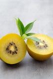 Kiwi fruit on a gray metal background. Stock Photos