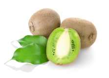 Kiwi fruit with green leaves Stock Images