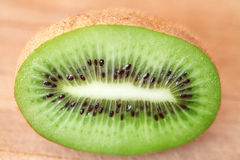 Kiwi fruit with green pulp and black seeds sliced Stock Photo