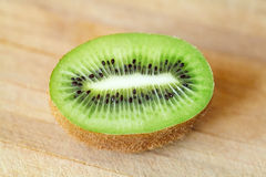 Kiwi fruit with green pulp and black seeds sliced Stock Image