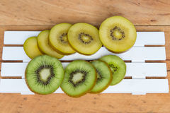 Kiwi fruit. Green and Yellow Kiwi cut and sliced. Royalty Free Stock Photo
