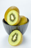 Kiwi fruit and half with black bowl Stock Photography