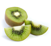 Kiwi fruit and his sliced segments Royalty Free Stock Image