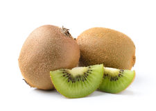 Kiwi fruit and his sliced segments Royalty Free Stock Images