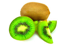 Kiwi fruit and his sliced segments isolated on white background Royalty Free Stock Photos