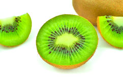 Kiwi fruit and his sliced segments isolated on white background Stock Images