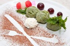 Kiwi Fruit Ice Cream. Color dessert of kiwi ice cream, with cream and chocolate Stock Photography