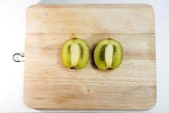 Kiwi fruit isolated on block. Two half kiwi fruit isolated on block wood , thailand Stock Photo