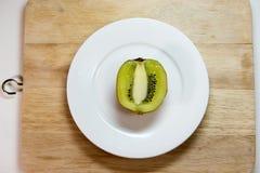 Kiwi fruit isolated on block and white dish decoration decoratio. N Stock Photo