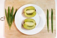 Kiwi fruit isolated on block and white dish decoration. Thailand Stock Image