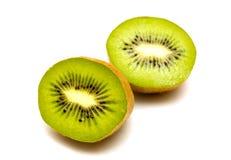 Kiwi fruit isolated on white background. Kiwi fruit, sliced on two parts. Liying on white background. Isolated Royalty Free Stock Photography