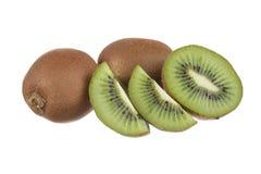 Kiwi fruit isolated on white. Whole kiwi fruit and his sliced segments isolated on white background Royalty Free Stock Photography