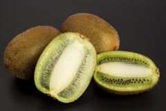 Kiwi fruit. Juicy kiwi fruit on gray background Stock Images
