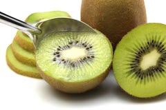 Kiwi fruit and kiwi sliced segments on white background Royalty Free Stock Photos