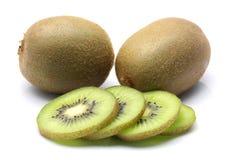Kiwi fruit and kiwi sliced segments on white background Royalty Free Stock Images