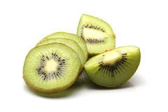 Kiwi fruit and kiwi sliced segments on white background Royalty Free Stock Photos