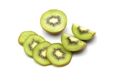 Kiwi fruit and kiwi sliced segments on white background Stock Photo