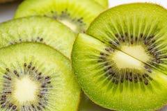 Kiwi fruit and kiwi sliced segments Royalty Free Stock Photos