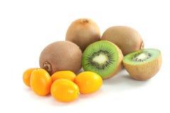 Kiwi fruit and kumquat. Ripe kiwi fruit and kumquat close up isolated on white Royalty Free Stock Image