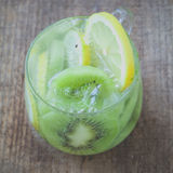 Kiwi fruit and lemon slice with soda water Stock Images