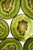 Kiwi fruit. Light shining through some fresh kiwi fruit stock images