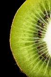 Kiwi Fruit Macro. Macro of Kiwi Fruit against solid Black Stock Images