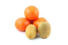 Kiwi fruit and mandarin orange Stock Photography