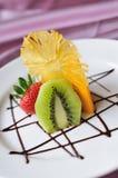 Kiwi Fruit ,mango and Strawberries on White. Fruit desserts. Kiwi Fruit ,mango and Strawberries on White Stock Images