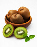 Kiwi fruit. With mint on a old white wooden background Stock Images
