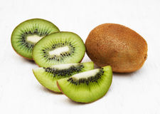 Kiwi fruit. With mint on a old white wooden background Royalty Free Stock Images