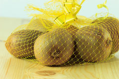 Kiwi fruit in a net Stock Image