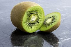 Kiwi Fruit with nutrition label Royalty Free Stock Photos