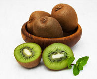 Kiwi fruit. On a old white wooden background Royalty Free Stock Photography