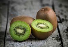 Kiwi fruit on old wooden Stock Image
