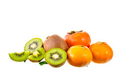 Kiwi fruit, orange and persimmon isolated on white background Royalty Free Stock Photo