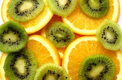 Kiwi fruit and orange slices. Kiwi and orange - are useful and delicious fruit on a white background Stock Photo