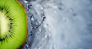 Kiwi fruit over water splashing Stock Photo