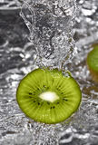Kiwi fruit over water splashing Royalty Free Stock Photo