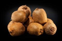 Kiwi fruit on pile. Stacked kiwi fruit isolated on black Stock Photography