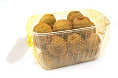 Kiwi fruit in plastic bowl isolated on white Stock Photography